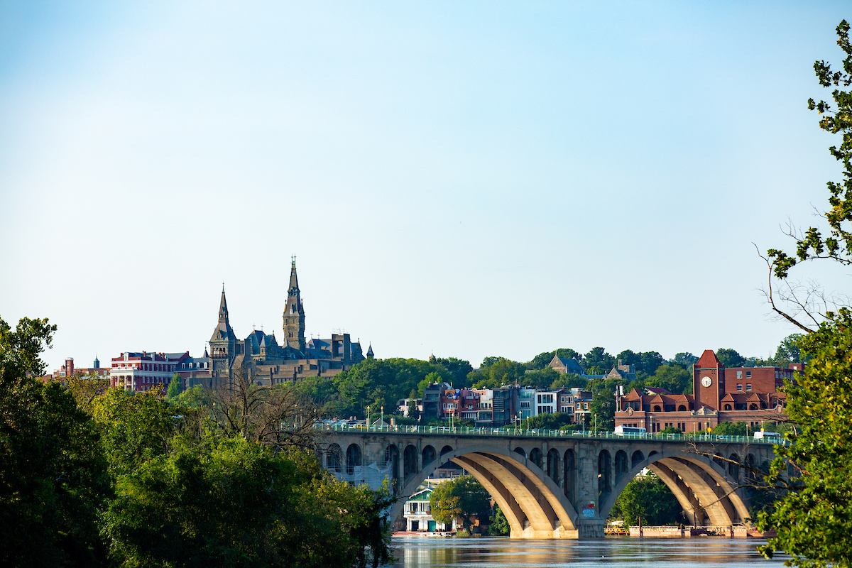 An image of the Key Bridge with Healy Hall and the Car Barn in the background